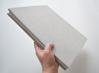 photo of hand holding a blank book